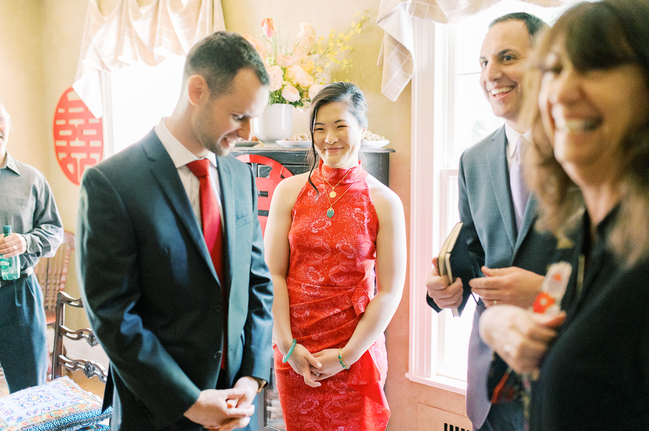 Justin, Sarah, and officiant Andy during Ketubah signing
