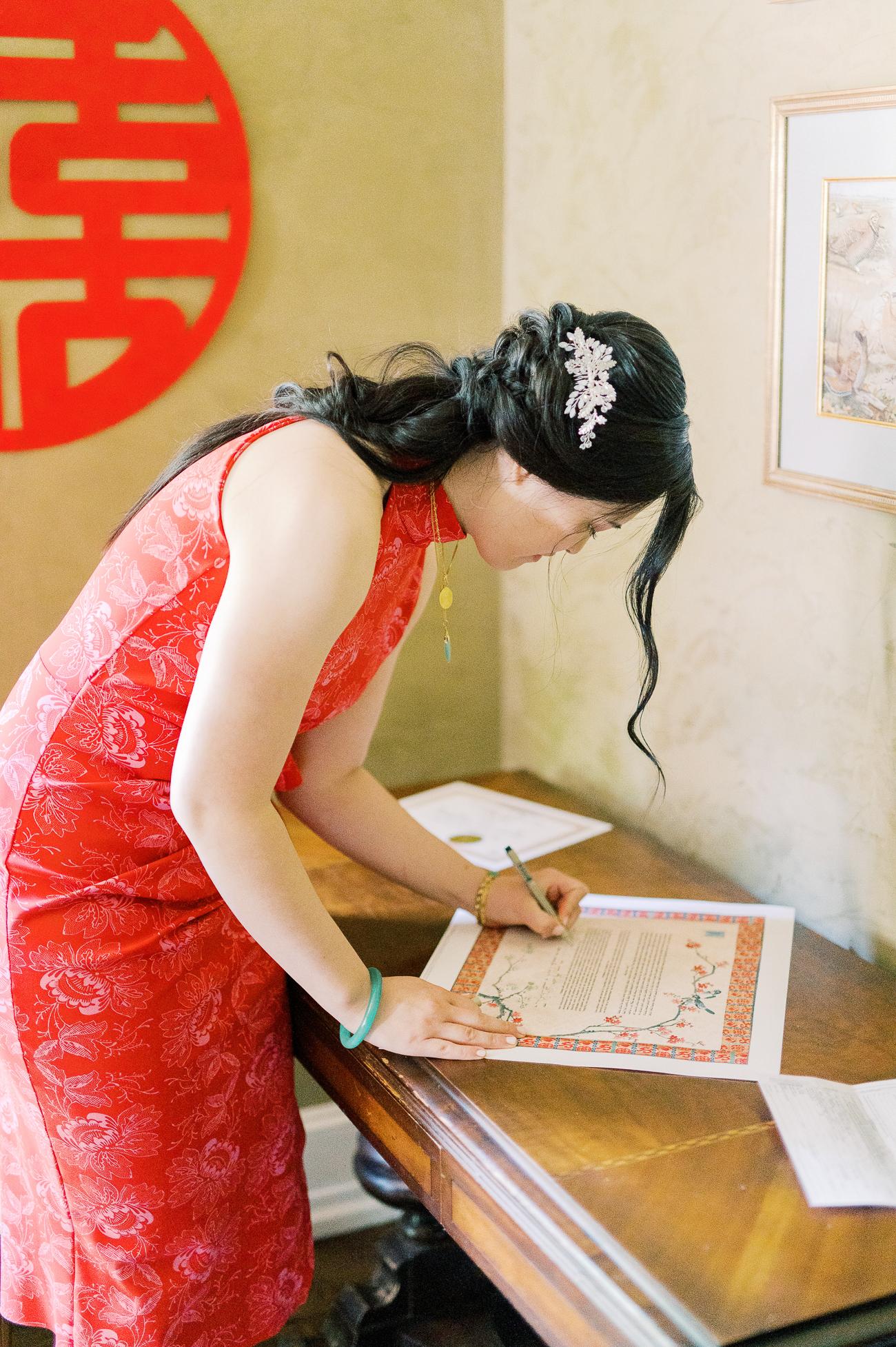 Sarah signing Ketubah