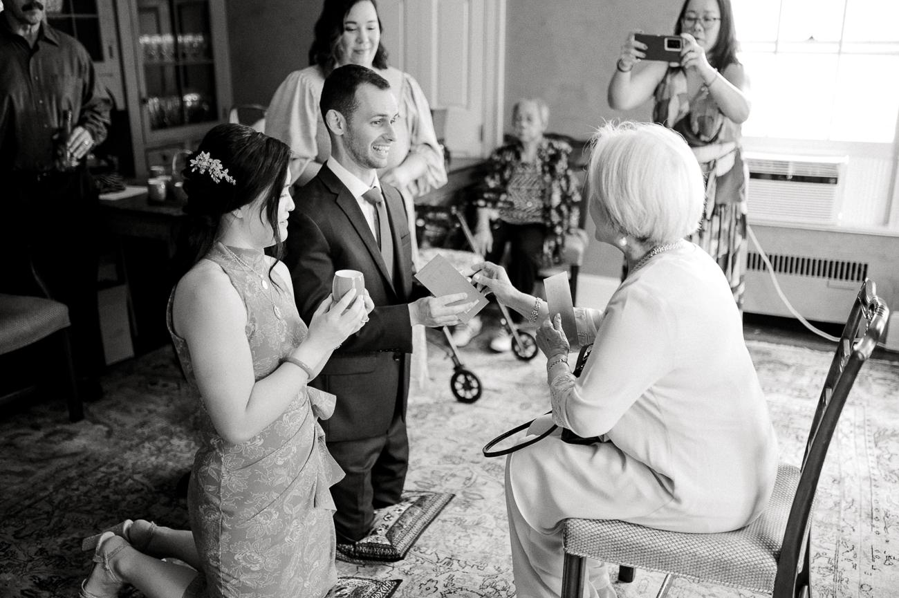 Sarah and Justin receiving a gift from Sarah's grandma