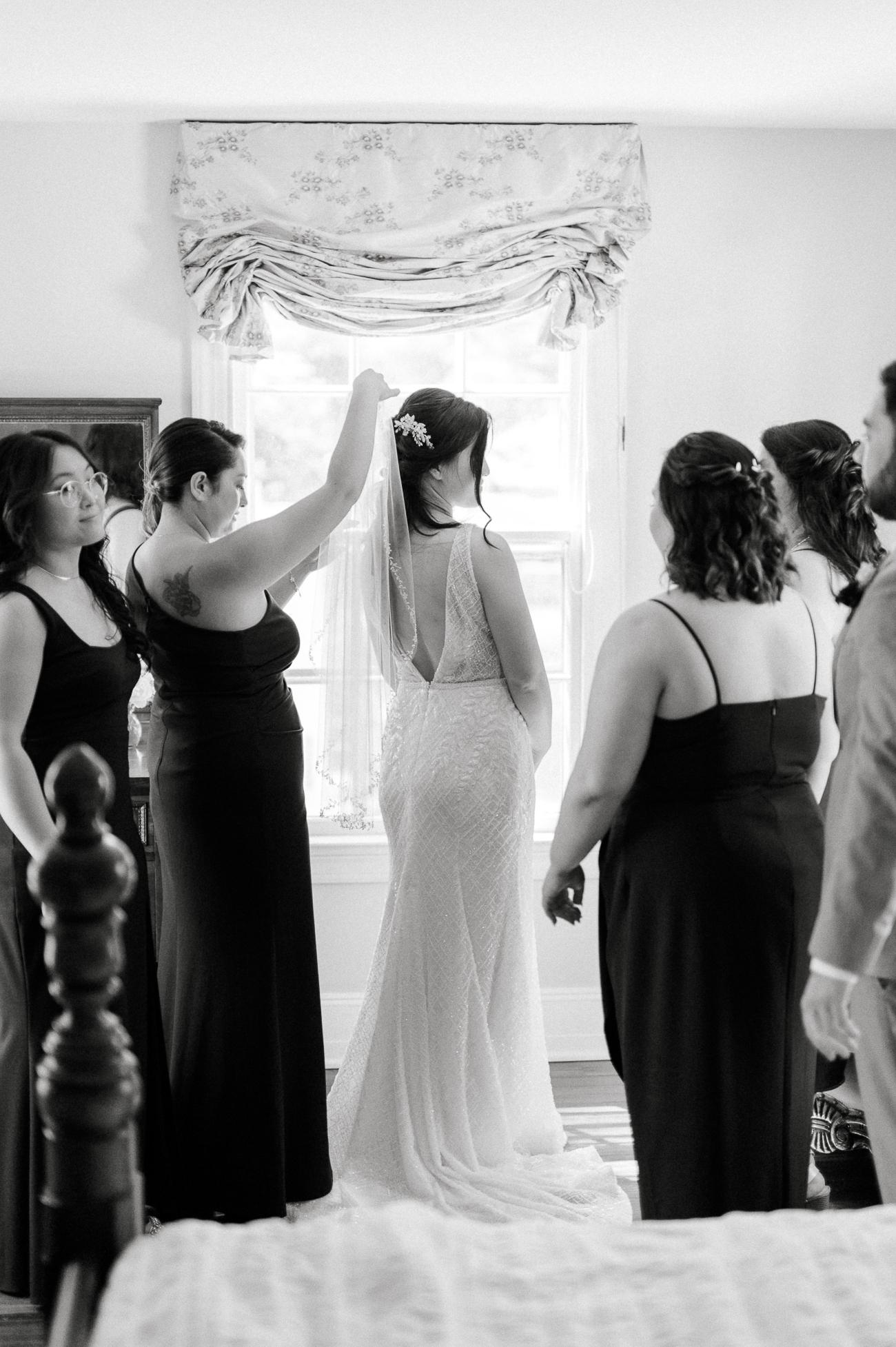Sarah's cousins helping with veil
