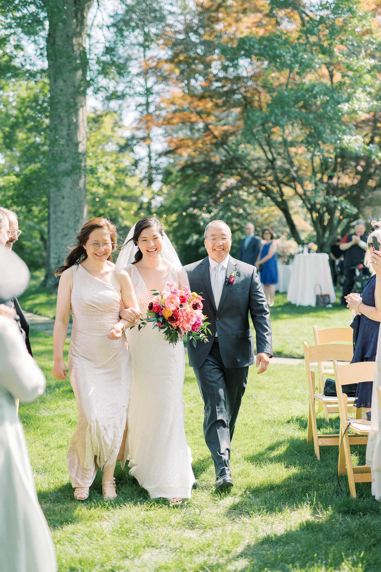 Sarah walking down the aisle with her parents