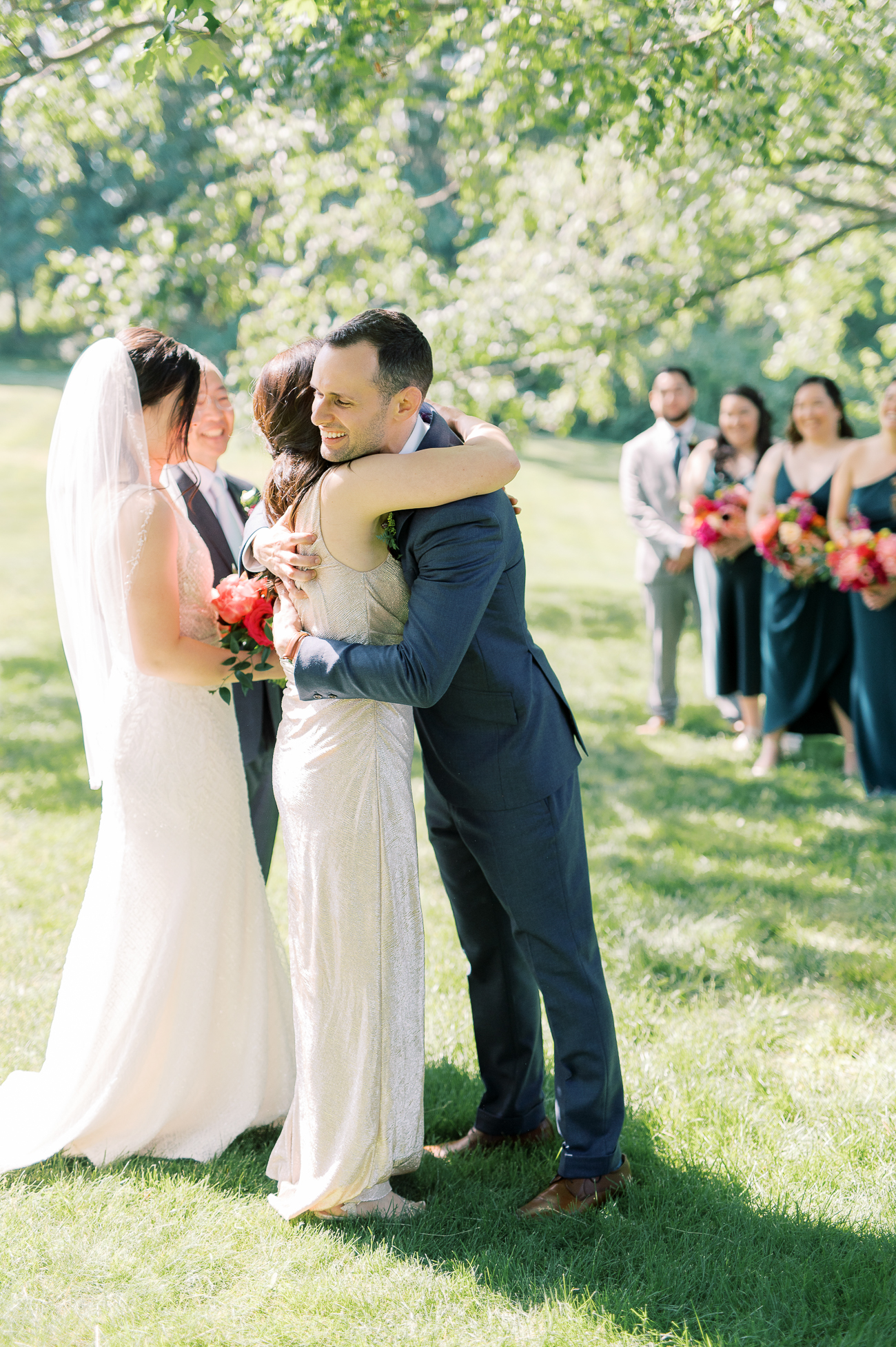 Justin hugging Judy at the end of the aisle