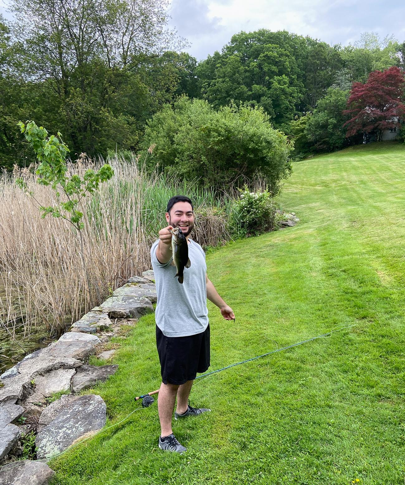 Chris holding up a bass