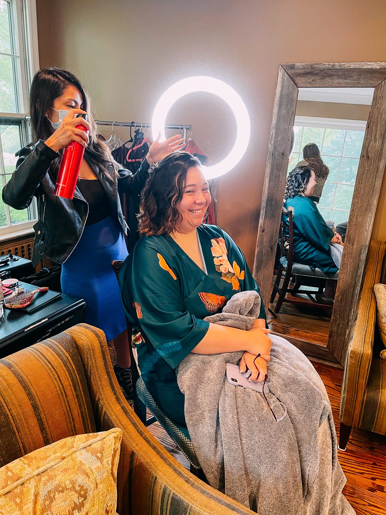 Kim getting her hair done
