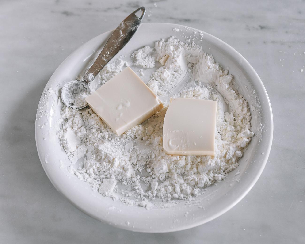 Dredging tofu in cornstarch
