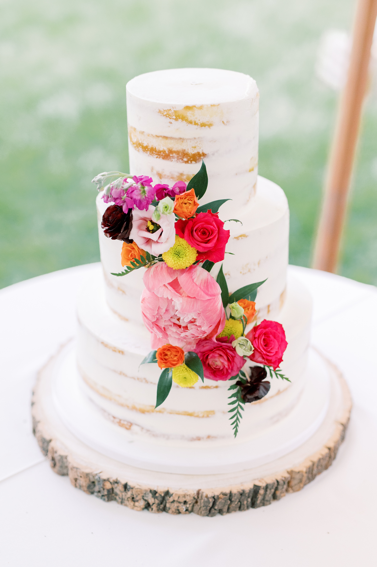 Naked wedding cake with floral decoration