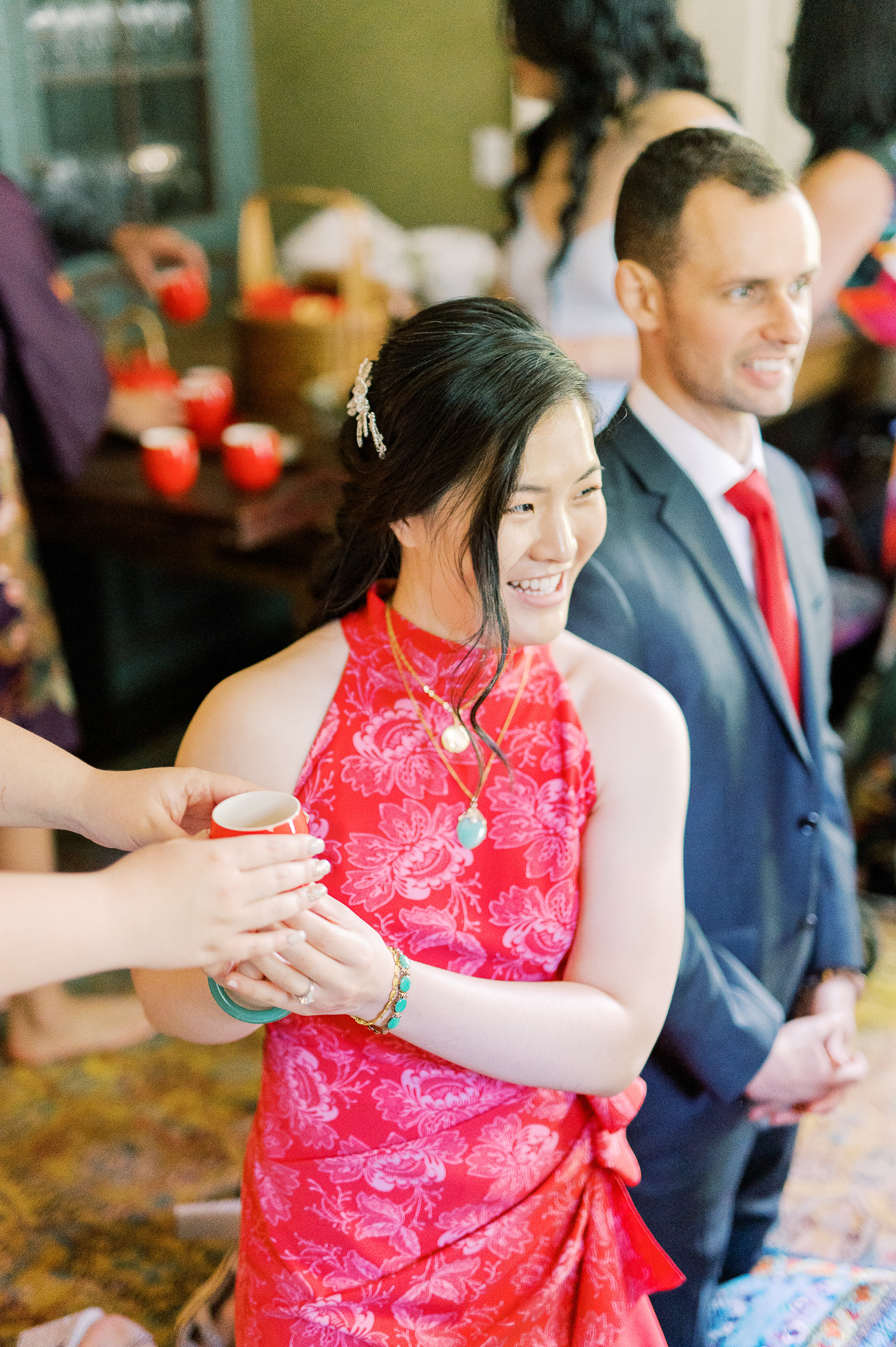Passing tea to bride during Chinese tea ceremony