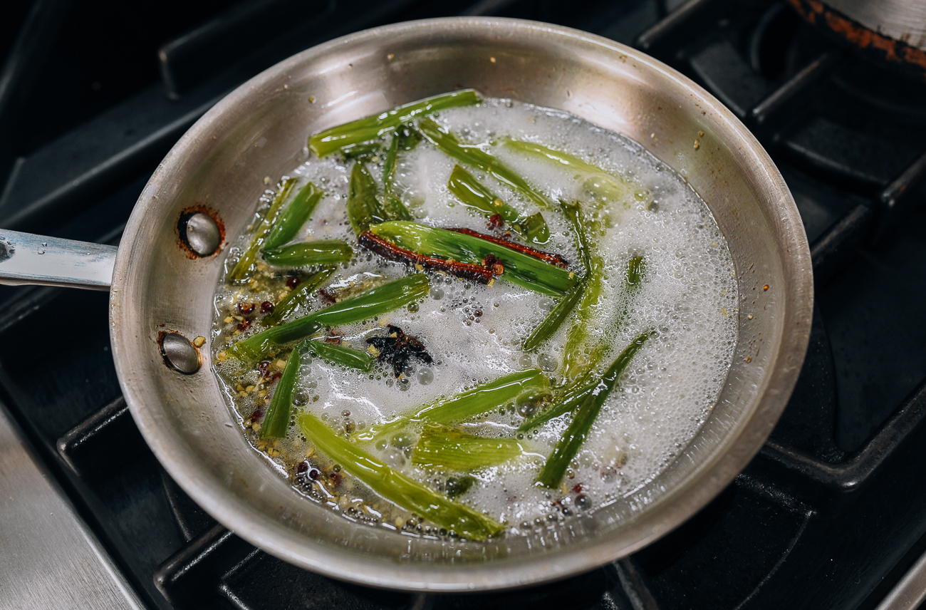 Infusing oil with scallions, garlic, and spices