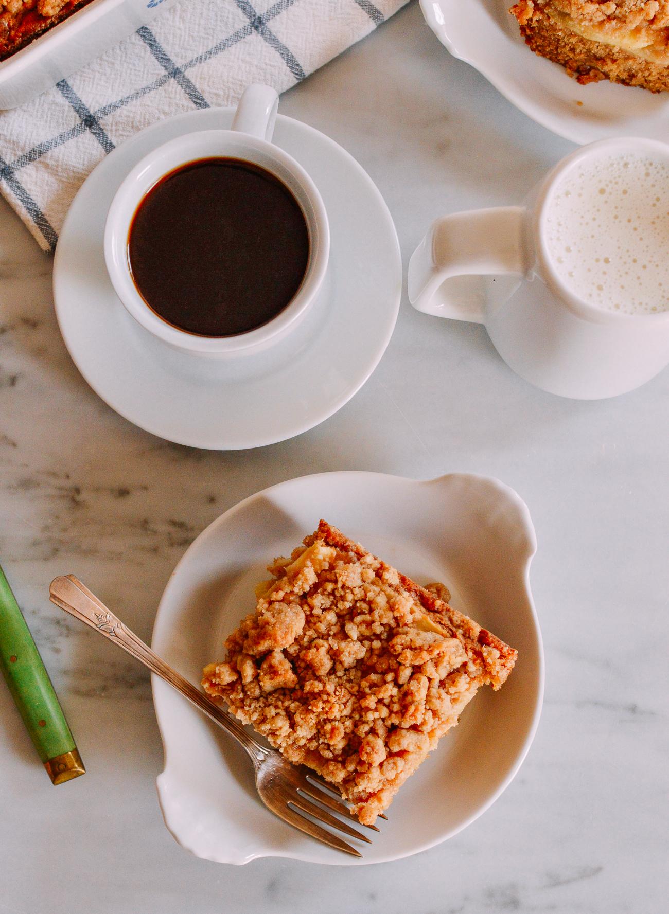 Apple cinnamon coffee cake with cup of coffee